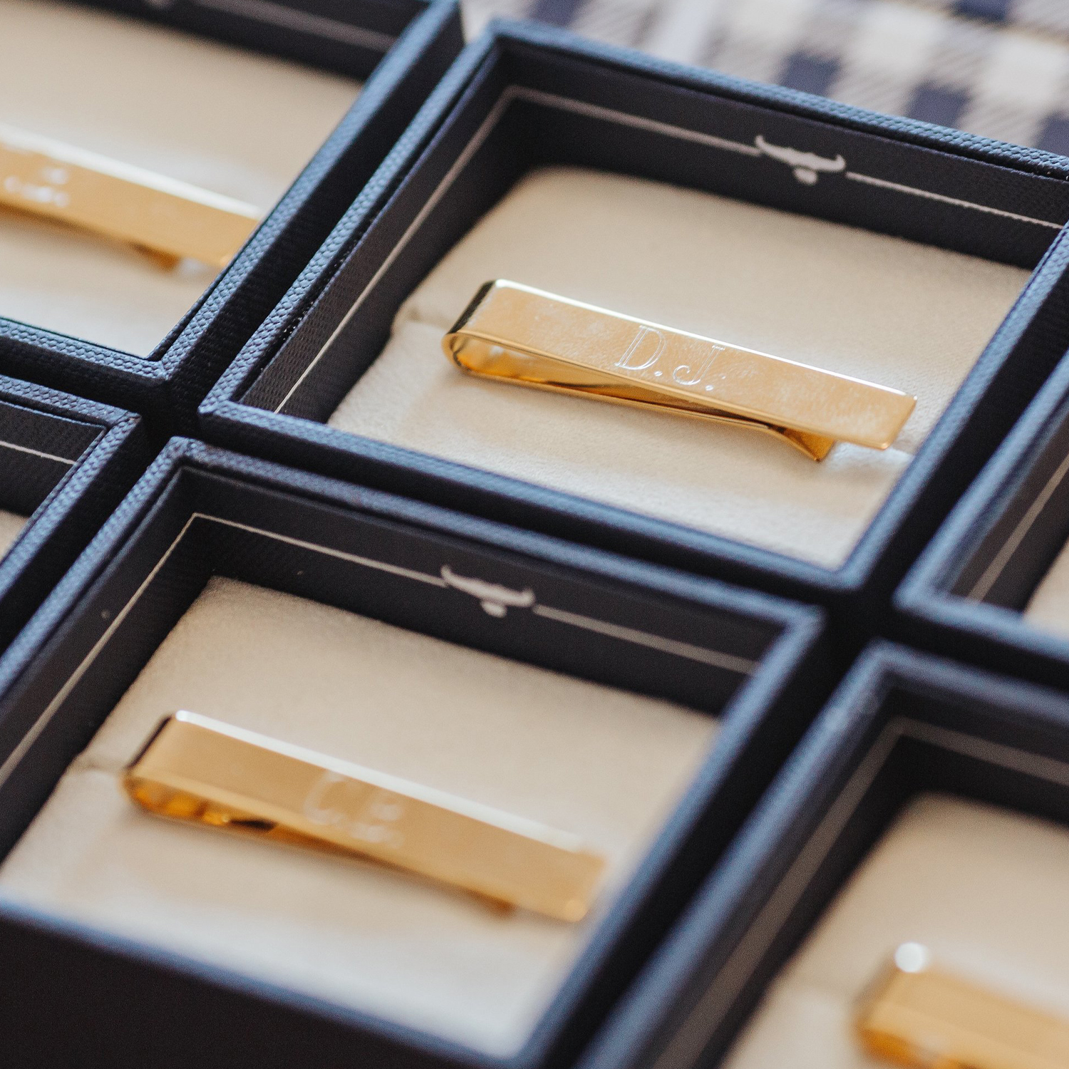 engraved tie bars in display boxes